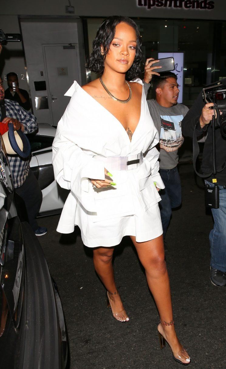 Rihanna steps out in low-cut dress amid body shaming