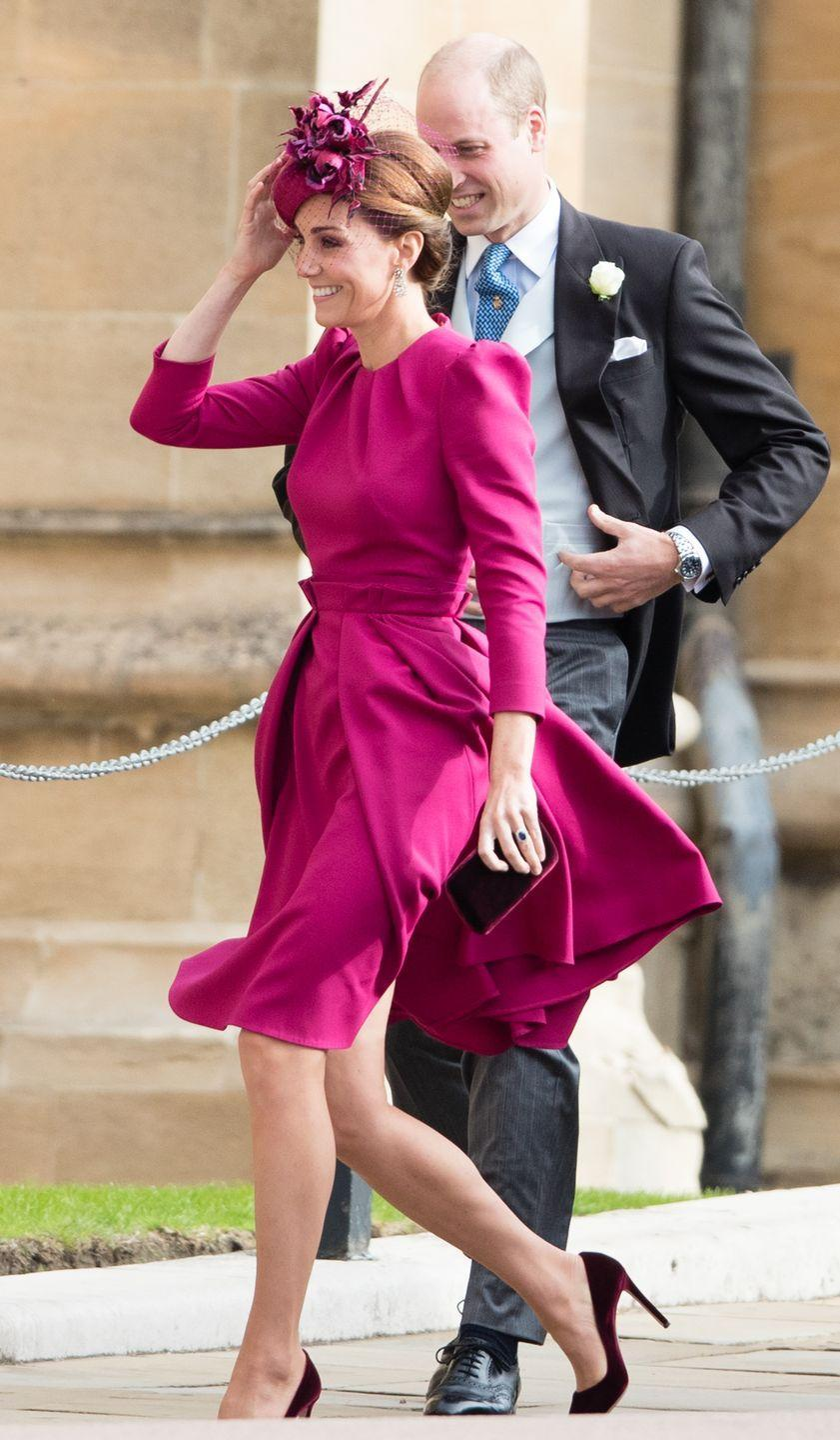 """<p>McQueen seems to be the royal wedding designer of choice. The Duchess wore this <a href=""""https://www.townandcountrymag.com/society/tradition/a23455715/kate-middleton-princess-eugenie-royal-wedding-outfit/"""" rel=""""nofollow noopener"""" target=""""_blank"""" data-ylk=""""slk:raspberry-colored dress"""" class=""""link rapid-noclick-resp"""">raspberry-colored dress</a> to her cousin-in-law, Princess Eugenie's wedding to Jack Brooksbank. </p>"""