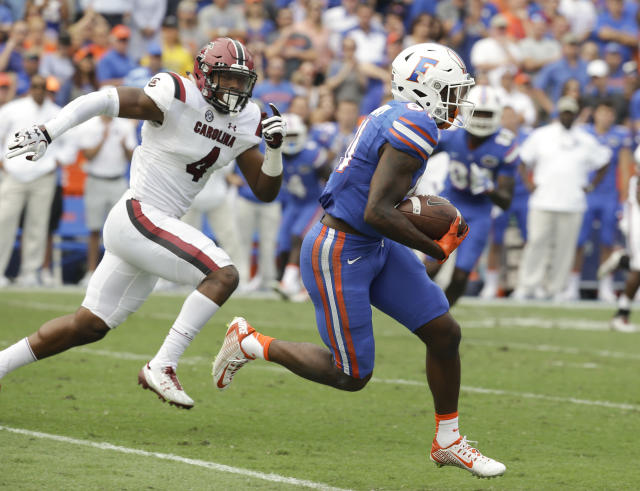 "Wide receiver <a class=""link rapid-noclick-resp"" href=""/ncaaf/players/255010/"" data-ylk=""slk:Antonio Callaway"">Antonio Callaway</a> is among nine Florida players potentially facing felony charges. (AP Photo/John Raoux, File)"