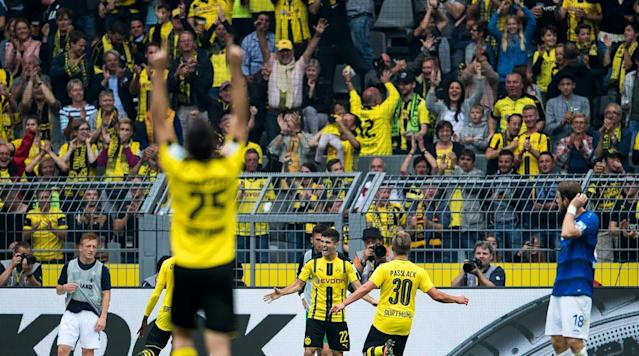 <p>Teammates of Borussia Dortmund celebrate the 3:0 goal of Christian Pulisic during the Bundesliga match against SV Darmstadt 98 at Signal Iduna Park on Sept. 17, 2016 in Dortmund, Germany.</p>