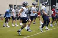 Tennessee Titans fullback Tory Carter (40) warms up during NFL football rookie minicamp Saturday, May 15, 2021, in Nashville, Tenn. (AP Photo/Mark Humphrey, Pool)