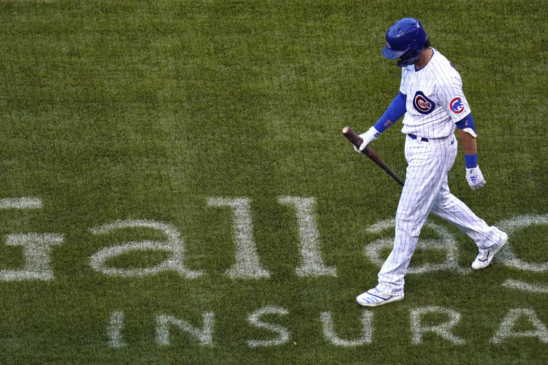 Chicago Cubs' Kris Bryant walks to the dugout after being called out on strikes during the first inning of a baseball game against the St. Louis Cardinals in Chicago, Sunday, Sept. 6, 2020. (AP Photo/Nam Y. Huh)