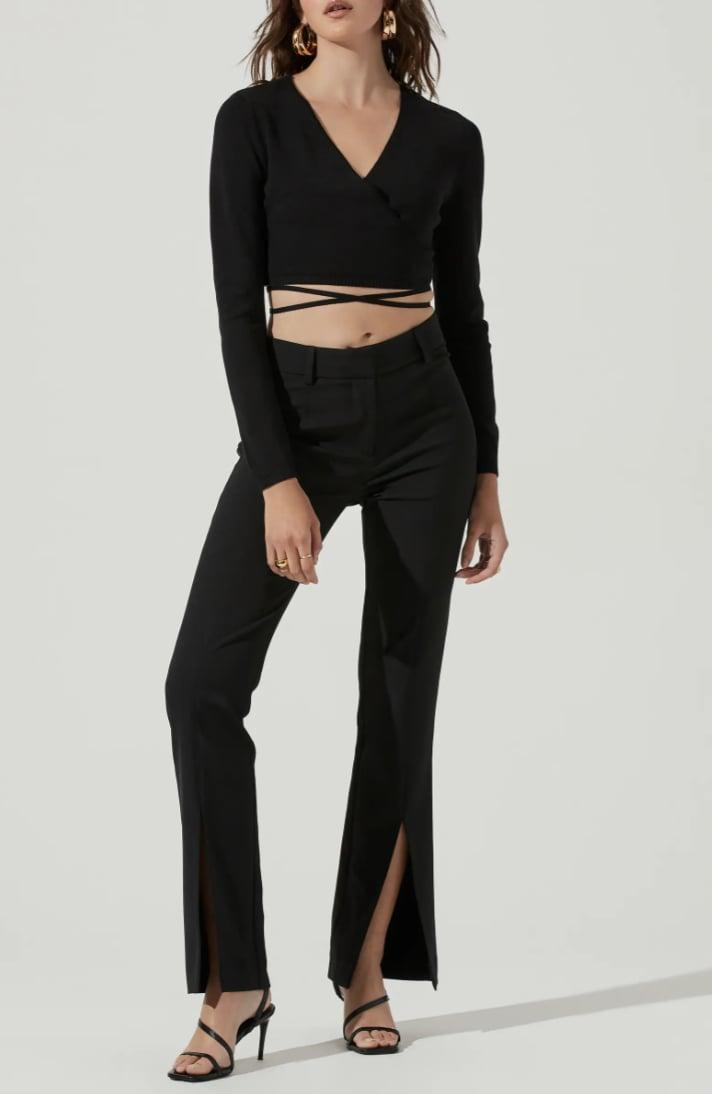 <p>The tie details and midriff baring style of this <span>ASTR the Label Tie Waist Wrap Sweater</span> ($69) make it modern and playful. Even with these updates, it has a timeless silhouette that is both fall-friendly and appropriate for year-round wear.</p>