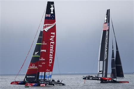 Emirates Team New Zealand (L) sails against Oracle Team USA (R) during Race 13 of the 34th America's Cup yacht sailing race in San Francisco, California September 20, 2013. REUTERS/Stephen Lam (UNITED STATES - Tags: SPORT YACHTING)