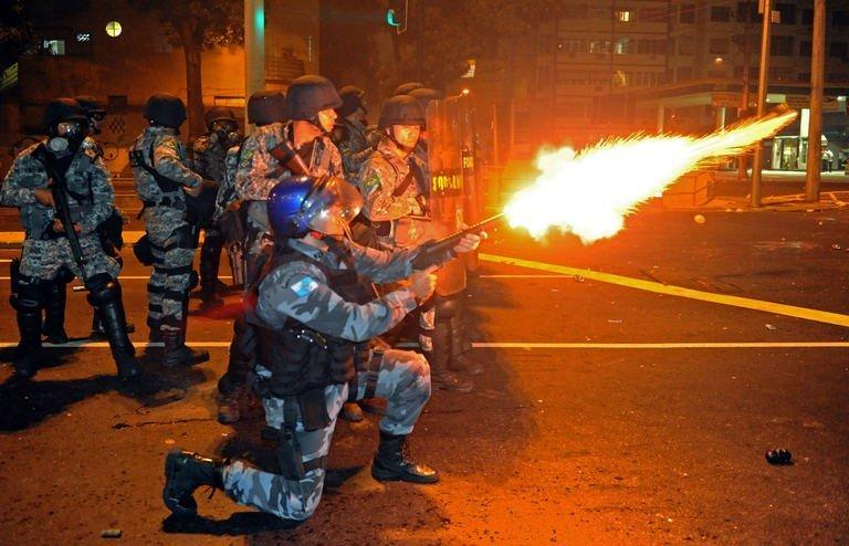 Riot squad officers clash with protestors on a street near Maracana stadium in Rio de Janeiro, Brazil on June 30, 2013