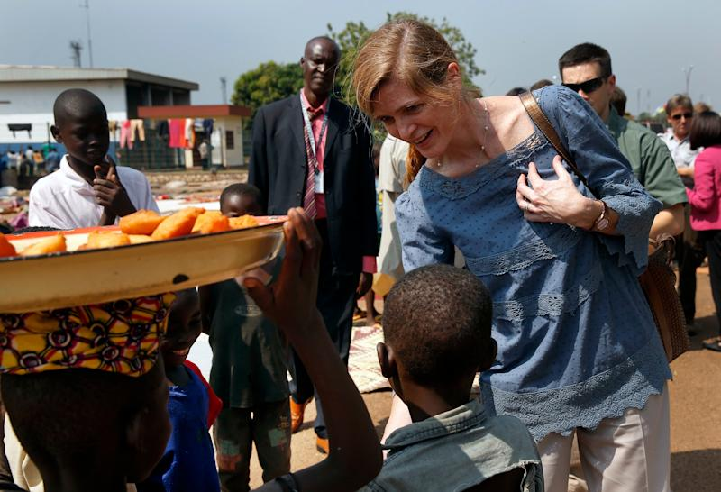 US Ambassador to the United Nations Samantha Power greets IDP children at the makeshift camp where over 40,000 people found refuge at the airport in Bangui, Central African Republic, Thursday, Dec. 19, 2013. Power is on a one day trip to the war stricken region. (AP Photo/Jerome Delay)
