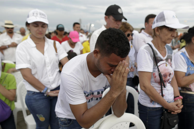 People pray during Mass celebrated by Pope Francis at the seaport in Cartagena, Colombia, Sunday, Sept. 10, 2017. (AP Photo/Ricardo Mazalan)