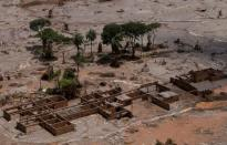 FILE PHOTO: The debris of the municipal school of Bento Rodrigues district, which was covered with mud after a dam owned by Vale SA and BHP Billiton Ltd burst, is pictured in Mariana