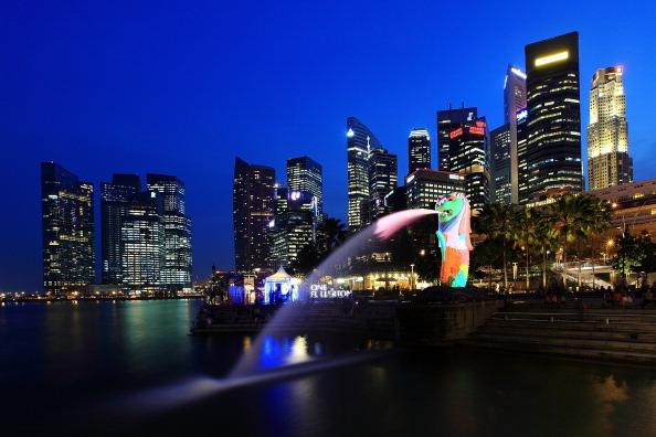 SINGAPORE - MARCH 28:  A general view of the Merlion and the central business district skyline on March 28, 2012 in Singapore. Singapore expects a slowdown in tourist arrival, with a forecast growth of 2.3 percent in 2012 as compared to 13 percent in 2011, according to the local media. (Photo by Suhaimi Abdullah/Getty Images)