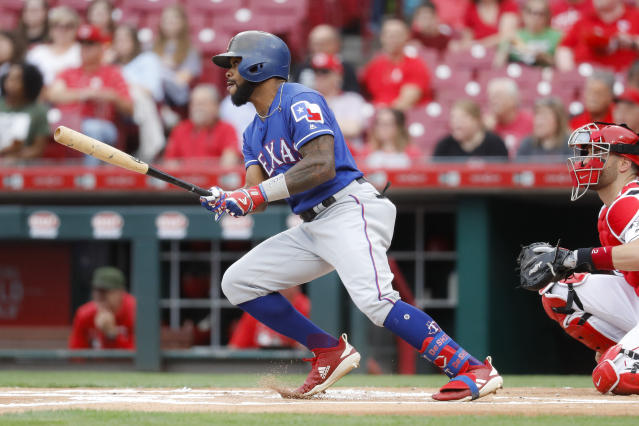 Texas Rangers' Delino DeShields hits a single off Cincinnati Reds starting pitcher Tyler Mahle in the first inning of a baseball game, Friday, June 14, 2019, in Cincinnati. (AP Photo/John Minchillo)