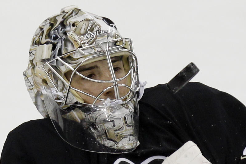 Pittsburgh Penguins goalie Marc-Andre Fleury (29) keeps his eye on a rebounding puck during the first period of an NHL hockey game against the Florida Panthers in Pittsburgh on Friday, March 9, 2012. (AP Photo/Gene J. Puskar)