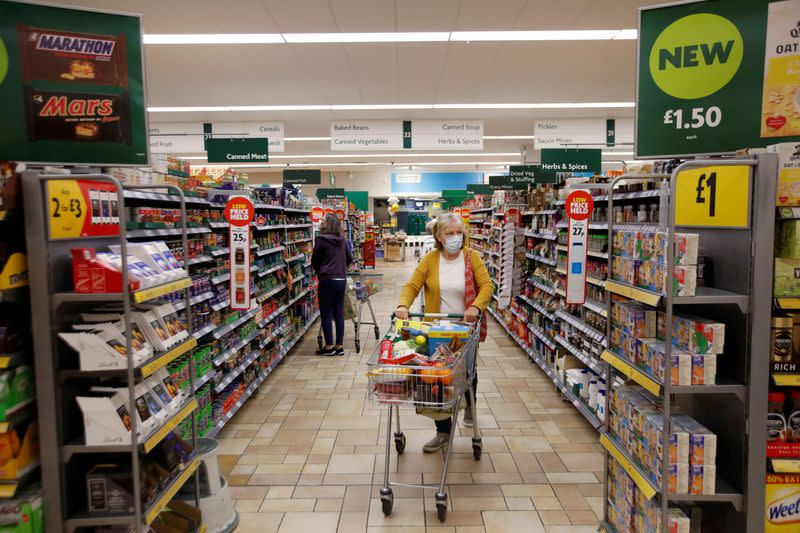 FILE PHOTO: A customer wearing a protective face mask shops at a Morrisons store in St Albans