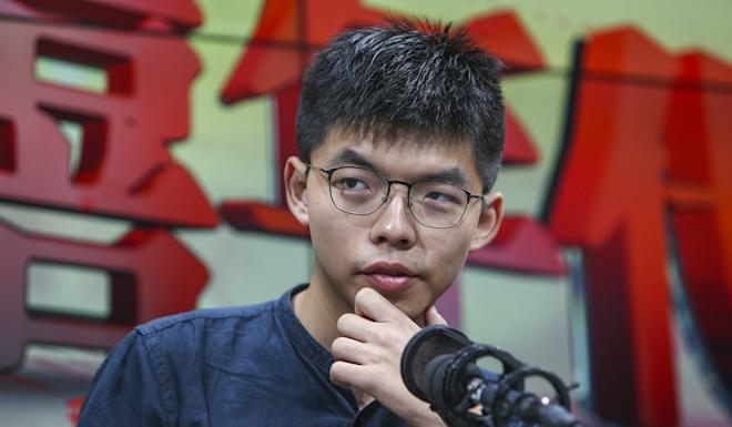 Joshua Wong Chi-fung talks about the extradition bill during an appearance on a radio programme. Photo: Winson Wong