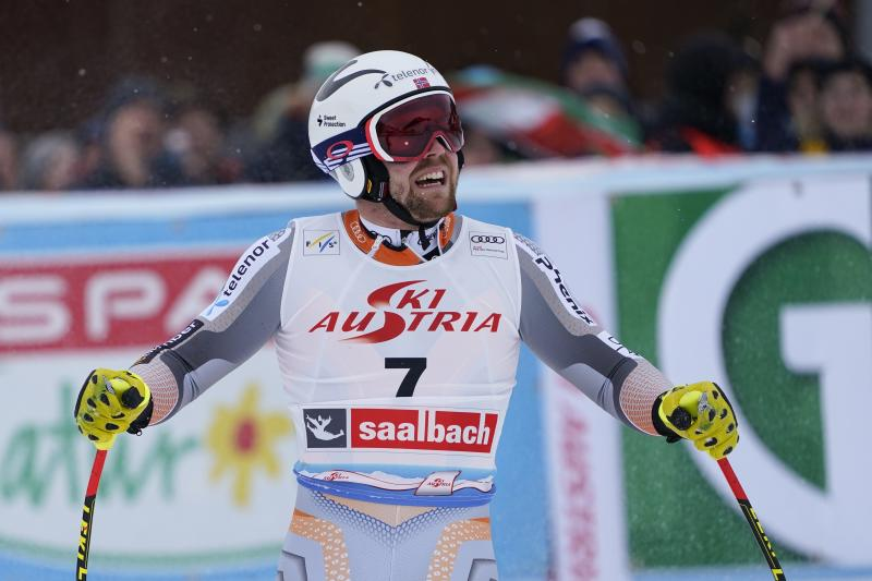 Norway's Aleksander Aamodt Kilde celebrates at the finish area of an alpine ski, men's World Cup Super G, in Saalbach-Hinterglemm, Austria, Friday, Feb. 14, 2020. (AP Photo/Giovanni Auletta)