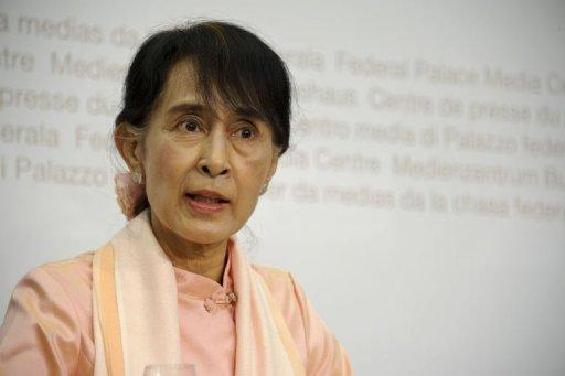 Myanmar opposition leader Aung San Suu Kyi speaks during a press conference in Bern
