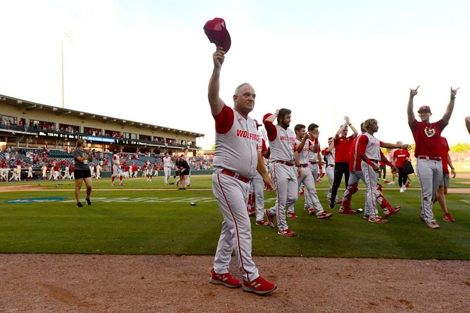 N.C. State coach Elliott Avent acknowledges the crowd after beating Arkansas 3-2 to advance to the College World Series during an NCAA college baseball super regional game Sunday, June 13, 2021, in Fayetteville, Ark.