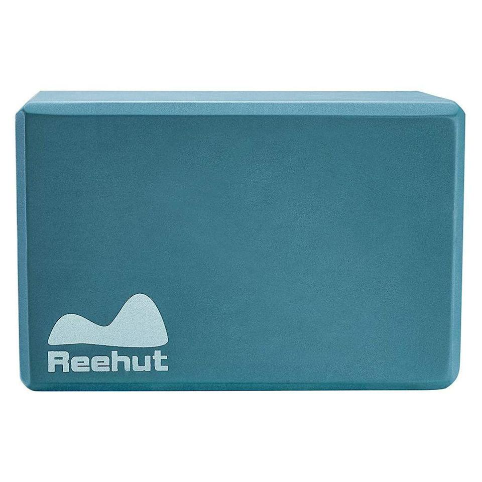 """<p><strong>Reehut</strong></p><p>amazon.com</p><p><strong>$8.99</strong></p><p><a href=""""https://www.amazon.com/REEHUT-2-PC-Yoga-Blocks-Flexibility/dp/B01M5BEAUE/ref?tag=syn-yahoo-20&ascsubtag=%5Bartid%7C2141.g.32420524%5Bsrc%7Cyahoo-us"""" rel=""""nofollow noopener"""" target=""""_blank"""" data-ylk=""""slk:Shop Now"""" class=""""link rapid-noclick-resp"""">Shop Now</a></p><p>This EVA-foam yoga block makes challenging stretches accessible, helping you lean into a camel pose or attempt a half moon by<strong> providing support without a high price tag</strong>. Note that a foam block like this is lightweight, so it's best if you count stability as a strength. </p>"""