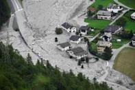 Searches resume for 8 missing in Swiss Alps landslide