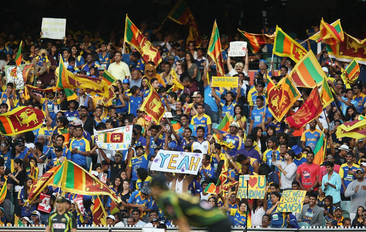 MELBOURNE, AUSTRALIA - JANUARY 28:  Sri Lankan fans enjoy the atmosphere during game two of the Twenty20 International series between Australia and Sri Lanka at the Melbourne Cricket Ground on January 28, 2013 in Melbourne, Australia.  (Photo by Scott Barbour/Getty Images)