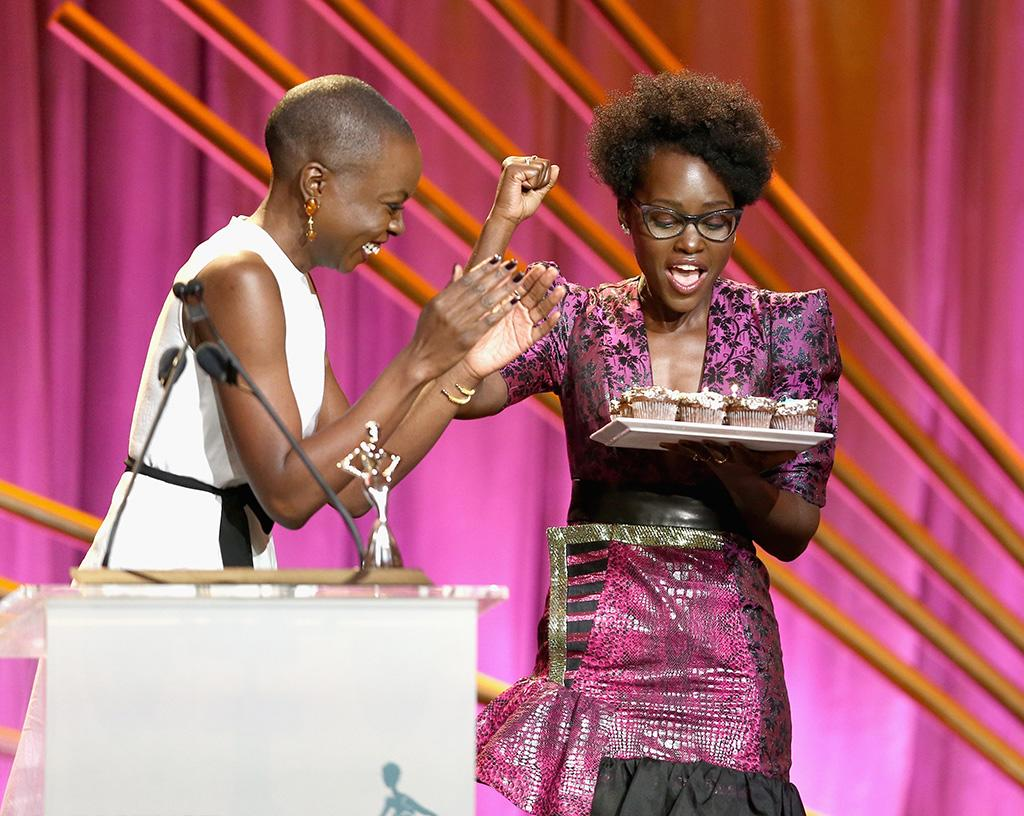 "<p>Gurira surprised her <em>Black Panthe</em>r co-star with birthday cupcakes onstage during the 2018 Essence Black Women In Hollywood Oscars Luncheon on Thursday in Beverly Hills, Calif. Nyong'o had pulled off her own surprise by flying in late the night before, to be on-hand to present her friend with an award. But it was Nyong'o who was shocked when Gurira led the audience in a rendition of ""Happy Birthday"" and gifted her with a tray of sweet treats for her 35th. ""I had to do that, I'm sorry,"" Gurira said. ""She just got off a plane late last night, made it here at midnight on her own birthday. That's sisterhood right there."" (Photo: Rich Polk/Getty Images for Essence) </p>"