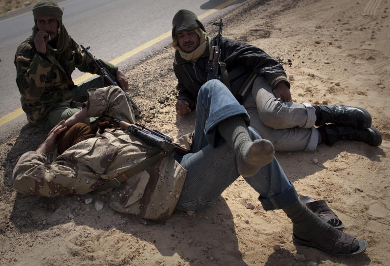 Libyan rebels take a rest on a checkpoint on the frontline near Zwitina, the outskirts of the city of Ajdabiya, south of Benghazi, eastern Libya, Thursday, March 24, 2011. (AP Photo/Anja Niedringhaus)