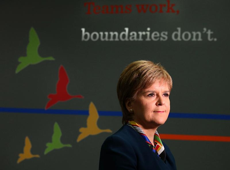 Theresa May says she will consult with Scotland's parliament on the shape of the final deal -- but Nicola Sturgeon's nationalists want a fresh referendum on independence after opposing Brexit (AFP Photo/Andrew Milligan)