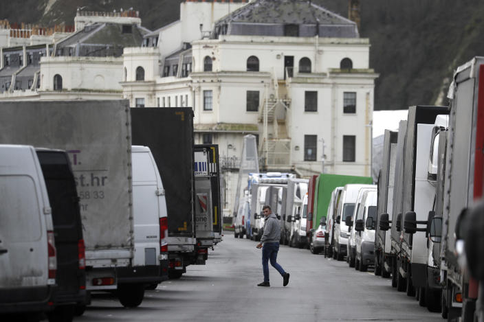 Goods vans wanting to return to Europe are parked along the seafront whilst the Port of Dover remains closed, in Dover, southern England, Tuesday, Dec. 22, 2020. Trucks waiting to get out of Britain are backed up for miles and people were left stranded at airports as dozens of countries around the world slapped tough travel restrictions on the U.K. because of a new and seemingly more contagious strain of the coronavirus in England.(AP Photo/Kirsty Wigglesworth)