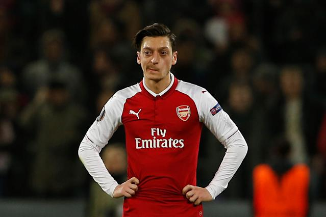 Mesut Ozil and Arsenal are all in on the Europa League. They learned their semifinal opponent at Friday's draw. (Getty)