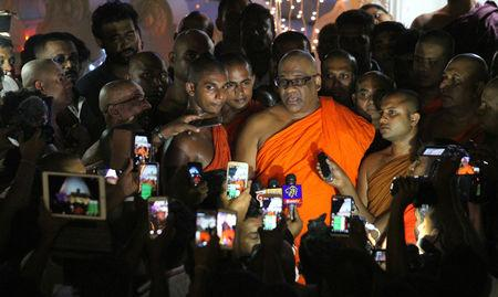 "Buddhist monk Gnanasara, head of the hardline Bodu Bala Sena or ""Buddhist Power Force"", speaks to media at a temple after leaving the prison with Sri Lanka's president Maithripala Sirisena's pardon in Colombo"