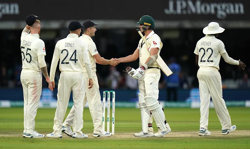 Australia's Pat Cummins shakes hands with England players after the second test is drawn. (Photo by John Walton/PA Images via Getty Images)