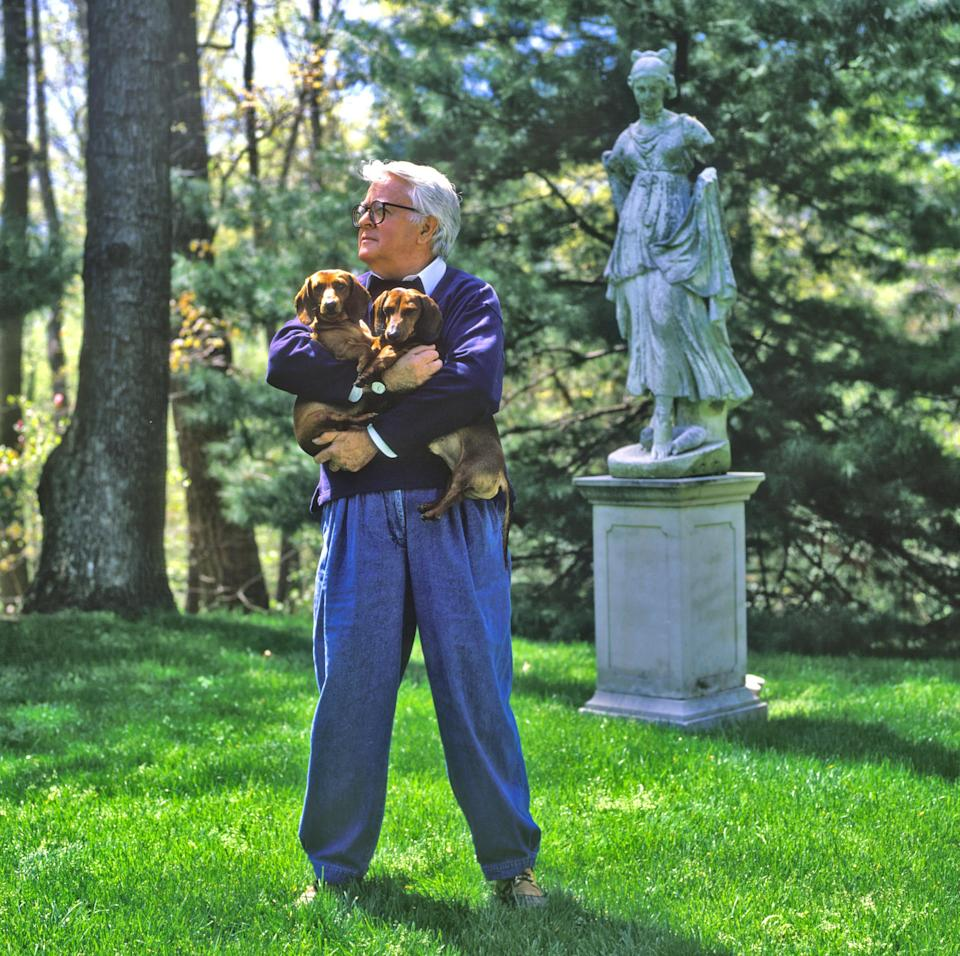 Geoffrey Beene at home with his dachshunds on Long Island in the summer of 1982. Photographed for New York magazine.