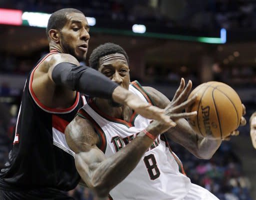 Milwaukee Bucks' Larry Sanders (8) drives past Portland Trail Blazers' LaMarcus Aldridge during the second half of an NBA basketball game Tuesday, March 19, 2013, in Milwaukee. The Bucks won 102-95. (AP Photo/Morry Gash)