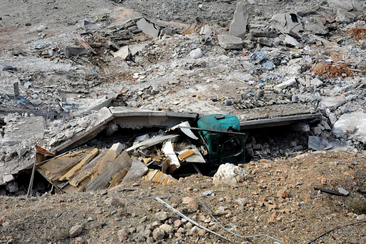This photo released by the Syrian official news agency SANA, shows damaged buildings wrecked by an Israeli airstrike in Damascus, Syria, Sunday, May 5, 2013. Israeli warplanes struck areas in and around the Syrian capital early Sunday, setting off a series of explosions as they targeted a shipment of highly accurate, Iranian-made guided missiles believed to be on their way to Lebanon's Hezbollah militant group, officials and activists said. The attack, the second in three days, signaled a sharp escalation of Israel's involvement in Syria's bloody civil war. Syria's state media reported that Israeli missiles struck a military and scientific research center near the Syrian capital and caused casualties. (AP Photo/SANA)