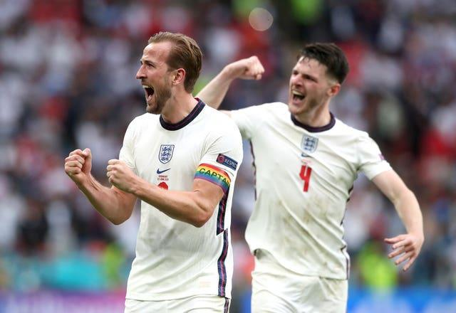 England's Harry Kane and Declan Rice celebrate after the final whistle