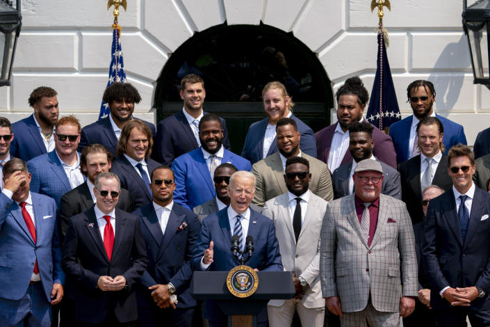 President Joe Biden, surrounded by members of the Tampa Bay Buccaneers, speaks during a ceremony on the South Lawn of the White House in Washington, Tuesday, July 20, 2021, where the president honored the Super Bowl Champion Tampa Bay Buccaneers for their Super Bowl LV victory. Tampa Bay Buccaneers Quarterback Tom Brady at right. (AP Photo/Andrew Harnik)