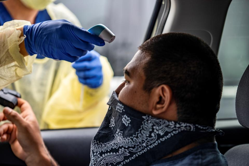 Joe Garcia has his heart rate and temperature checked before getting tested for the coronavirus disease (COVID-19) during its outbreak, in Austin, Texas in June. (Sergio Flores/Reuters)