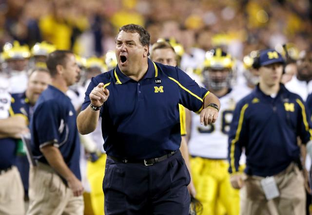 Michigan coach Brady Hoke yells at officials during the first half of the Buffalo Wild Wings Bowl NCAA college football game against Kansas State on Saturday, Dec. 28, 2013, in Tempe, Ariz. (AP Photo/Ross D. Franklin)