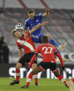 Southampton's James Ward-Prowse, left, and Leicester's Luke Thomas challenge for the ball during the English Premier League soccer match between Southampton and Leicester City at St. Mary's Stadium in Southampton, England, Friday, April 30, 2021. (AP Photo/Kirsty Wigglesworth, Pool)