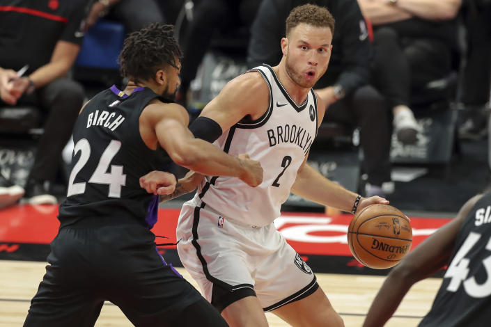 Toronto Raptors' Khem Birch (24) defends against Brooklyn Nets' Blake Griffin during the second half of an NBA basketball game Wednesday, April 21, 2021, in Tampa, Fla. (AP Photo/Mike Carlson)
