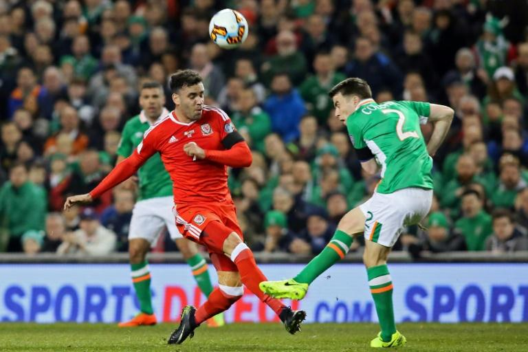Wales's striker Hal Robson-Kanu vies with Republic of Ireland's defender Seamus Coleman (R) during the World Cup 2018 qualification football match March 24, 2017