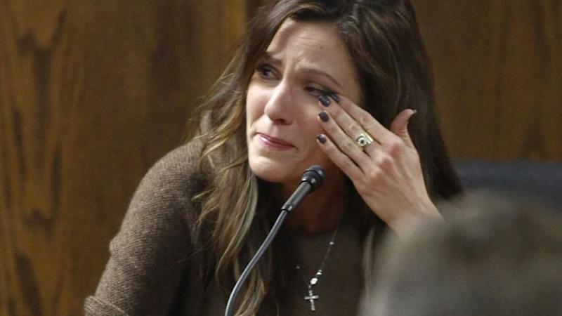 Taya Kyle, wife of slain Navy SEAL Chris Kyle, wipes away tears when viewing images of her husband during her testimony on the witness stand. Source: AP