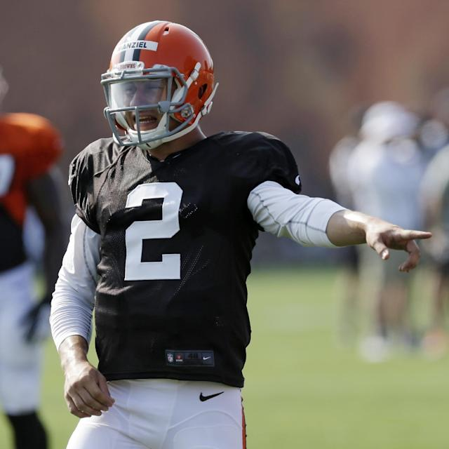 Cleveland Browns quarterback Johnny Manziel gives a signal teammates during practice at the NFL football team's training camp Monday, Aug. 4, 2014, in Berea, Ohio. (AP Photo/Tony Dejak)