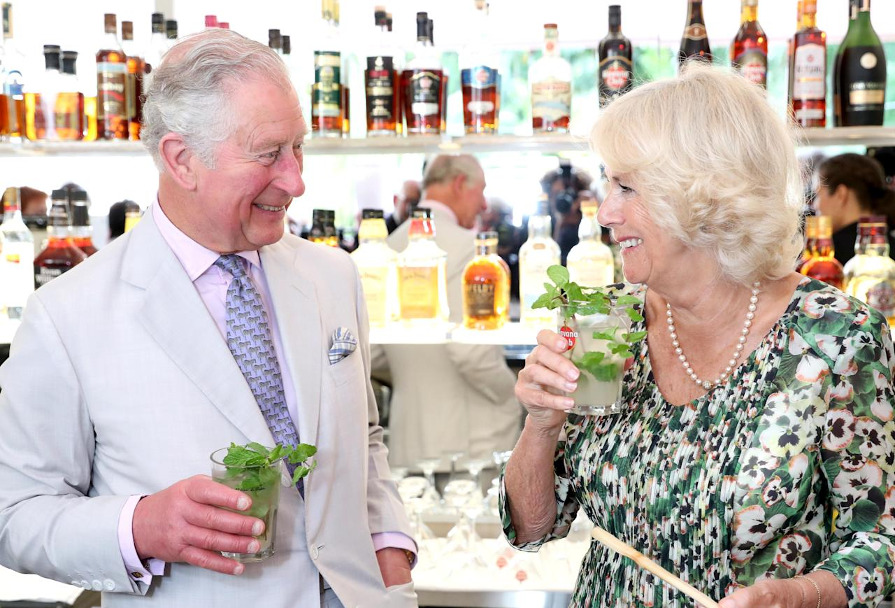 <p>Charles and Camilla sip their mojitos after a cocktail making class in Cuba [Photo: Getty] </p>