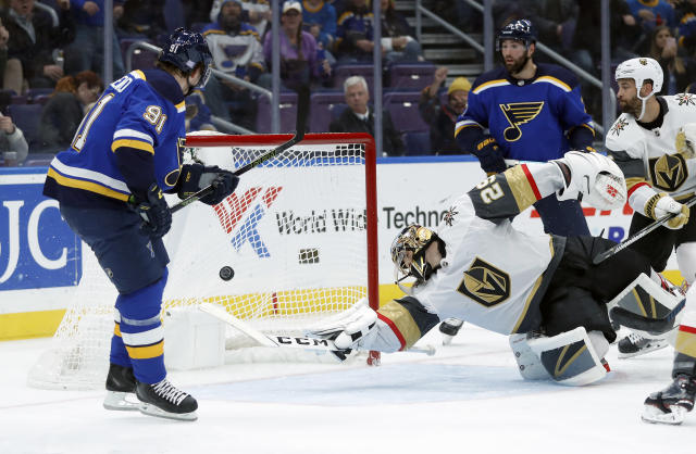 St. Louis Blues' Vladimir Tarasenko, left, of Russia, scores past Vegas Golden Knights goaltender Marc-Andre Fleury (29) during the second period of an NHL hockey game Thursday, Nov. 1, 2018, in St. Louis. (AP Photo/Jeff Roberson)