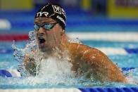 Michael Andrew participates in the Men's 100 Breaststroke during wave 2 of the U.S. Olympic Swim Trials on Monday, June 14, 2021, in Omaha, Neb. (AP Photo/Jeff Roberson)