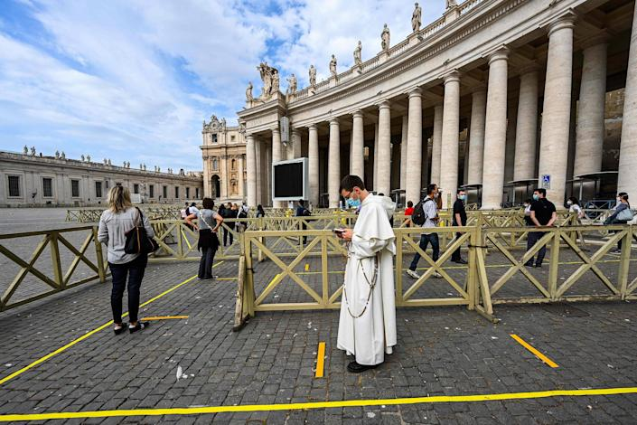 Image: People line up in respect of security distancing to access St. Peter's Basilica on May 18, 2020 in The Vatican during the lockdown aimed at curbing the spread of the COVID-19 infection, caused by the novel coronavirus. (Vincnenzo Pinto / AFP - Getty Images)