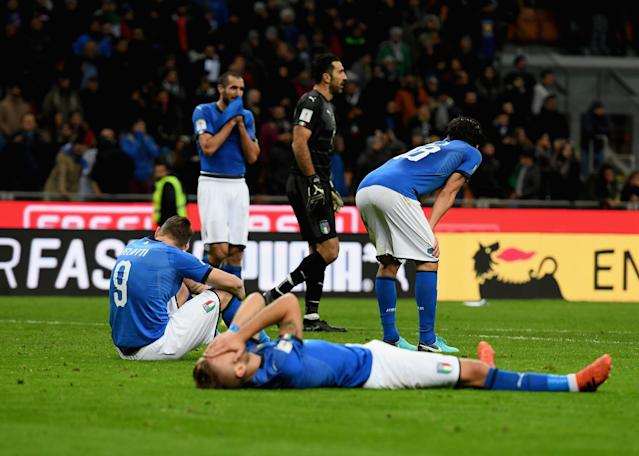 Italy players lie on the San Siro pitch and rue their failure to qualify for the 2018 World Cup. (Getty)