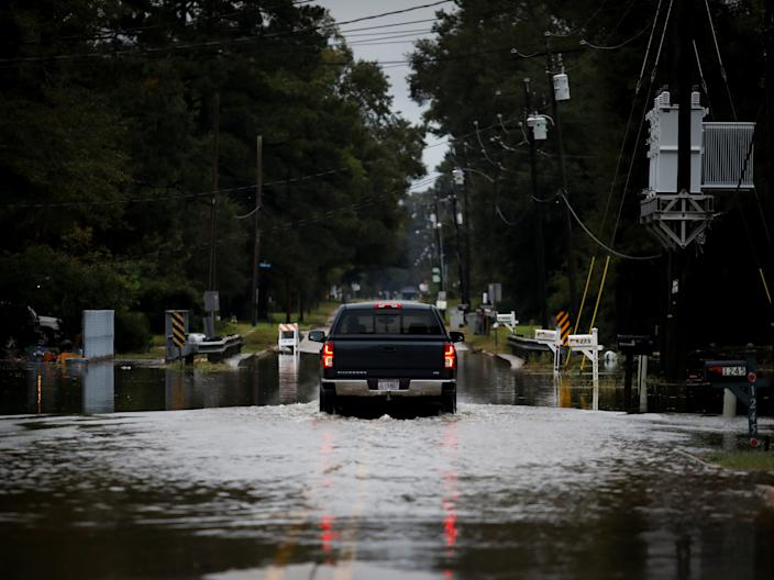 Hurricane delta flooding louisiana car street baker