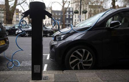Electric cars are plugged into a charging point in London, Britain, April 7, 2016. REUTERS/Neil Hall/File Photo