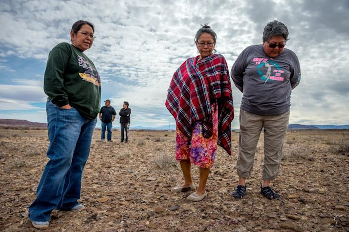 Sisters Linda Talker, Carol Talker, and Leona Begishie walk near their family home in Cameron, AZ. (Photograph by Mary F. Calvert)